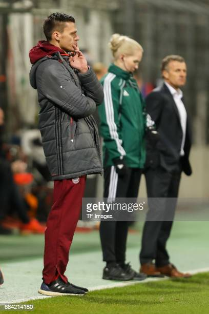 ChefHead coach Thomas Woerle of Bayern Munich looks on during the Champions League match between Bayern Munich and Paris Saint Germain at Municipal...