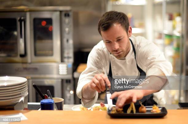 Chef/owner Alex Figura works in the open kitchen space at the new Lower 48 Kitchen at 2020 Lawrence Street in downtown Denver on Wednesday January 29...