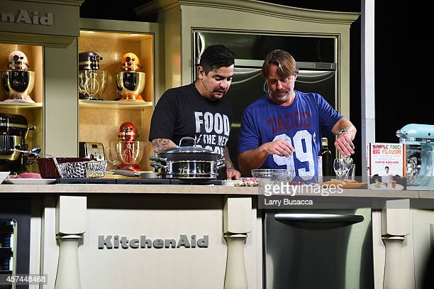 Chefs Aaron Sanchez and John Besh give a cooking demonstration at the Grand Tasting presented by ShopRite featuring KitchenAid® culinary...
