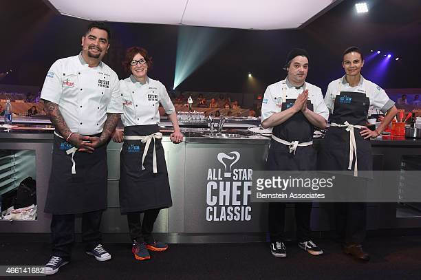 Chefs Aaron Sanchez Suzanne Goin Jenn Louis and Brooks Headley pose for a photo at AllStar Chef Classic Cuisine for the Cure presented by Melissa's...