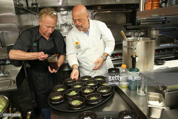 Chefs Andrew Zimmern and JP Samuelson prepare dinner during the Bank Of America Dinner series at Cote Korean Steakhouse on October 11 2018 in New...