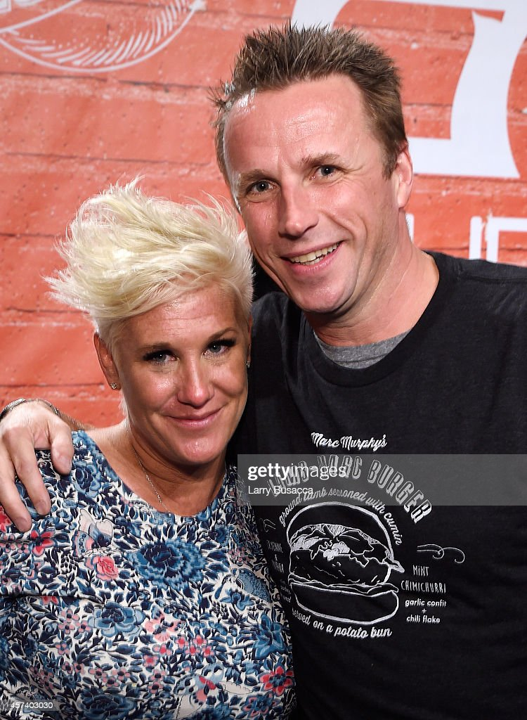 Chefs Anne Burrell and Marc Murphy pose together at the Blue Moon Burger Bash presented by Pat LaFrieda Meats hosted by Rachael Ray during the Food Network New York City Wine & Food Festival Presented By FOOD & WINE at Esurance Rooftop Pier 92 on October 17, 2014 in New York City.