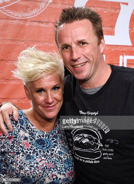 Chefs Anne Burrell and Marc Murphy pose together at the Blue Moon Burger Bash presented by Pat LaFrieda Meats hosted by Rachael Ray during the Food...