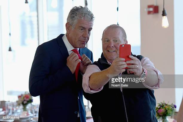 Chefs Anthony Bourdain and Mario Batali take a selfie at The Supper hosted by Mario Batali with Anthony Bourdain on June 2 2016 in New York City