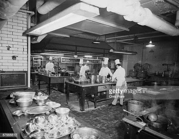 Chefs at work in the kitchen of the Ritz Hotel in London, 29th May 1963.