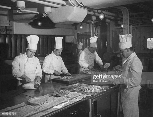 Chefs at work in the kitchens on board the Cunard White Star liner RMS Queen Mary, during a transatlantic crossing, August 1939. Original...
