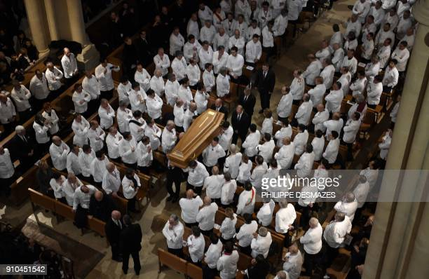 Chefs carry the coffin of French chef Paul Bocuse during the funeral ceremony at the SaintJean Cathedral in Lyon on January 26 2018 More than 1500...