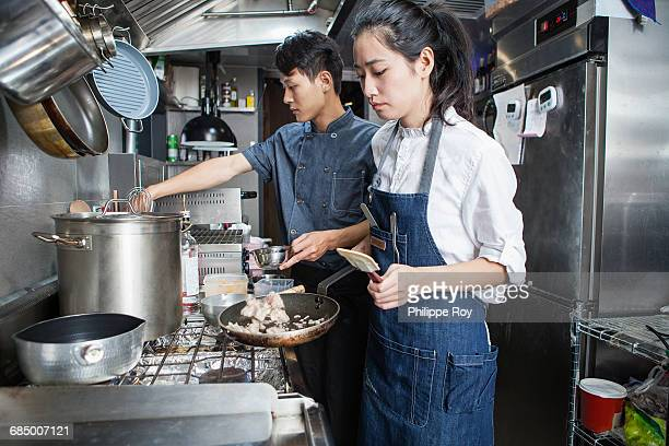 Chefs cooking in commercial kitchen