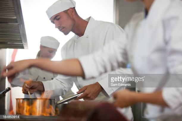 Chefs cooking in restaurant kitchen