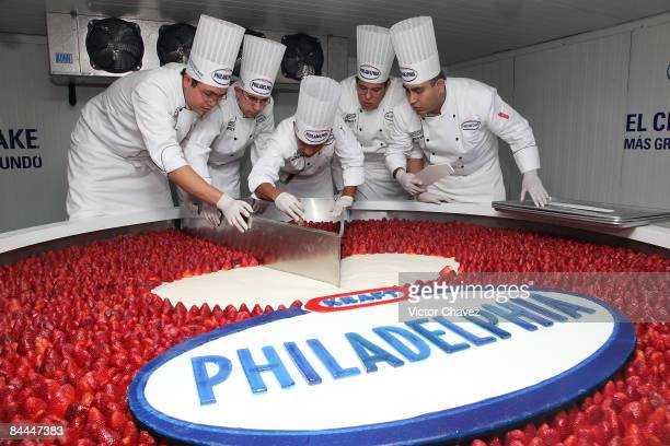 Chefs cut the Guinness World Recordwinning biggest cheesecake made by KRAFT Philadelphia which is 25 meters in diameter 55 centimeters high and...