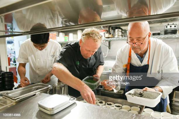 Chefs David Shim JP Samuelson and Andrew Zimmern prepare dinner during the Bank Of America Dinner series at Cote Korean Steakhouse on October 11 2018...