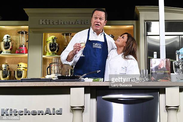 Chefs David Venable and Rachael Ray give a cooking demonstration at the Grand Tasting presented by ShopRite featuring KitchenAid® culinary...