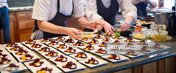 chef's dishing up - banquet stock pictures, royalty-free photos & images