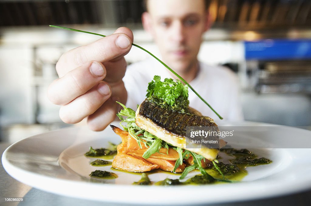 chefs doing kitchen preparation and service  : Stock Photo