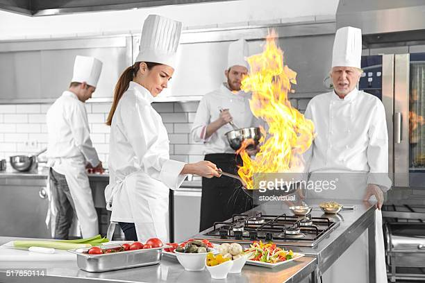 Chefs flame in the kitchen