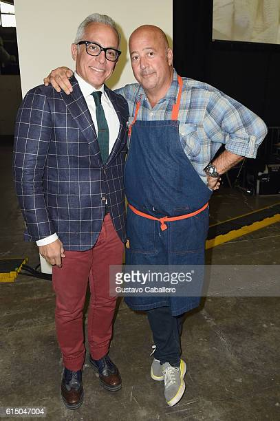 Chefs Geoffrey Zakarian and Andrew Zimmern pose during the Grand Tasting presented by ShopRite featuring Samsung culinary demonstrations presented by...