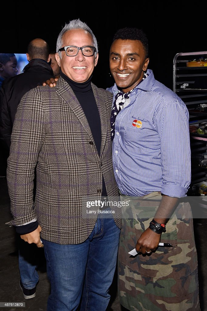 Chefs Geoffrey Zakarian (L) and Marcus Samuelsson pose backstage at the Grand Tasting presented by ShopRite featuring KitchenAid® culinary demonstrations presented by MasterCard during the Food Network New York City Wine & Food Festival Presented By FOOD & WINE at Pier 94 on October 19, 2014 in New York City.
