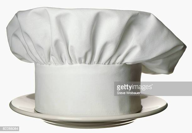 chefs hat or toque on white dinner plate