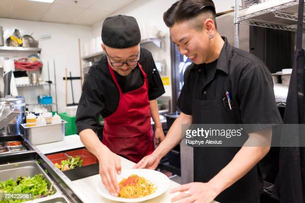 chefs in kitchen preparing food - korean food stock pictures, royalty-free photos & images