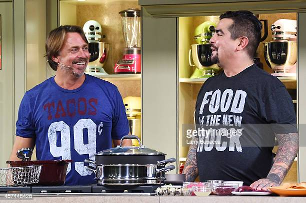 Chefs John Besh and Aaron Sanchez give a cooking demonstration at the Grand Tasting presented by ShopRite featuring KitchenAid® culinary...