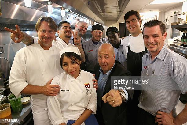 Chefs John Besh and Aaron Sanchez tv personality Andrew Zimmern and chefs pose at the Johnny Sanchez Dinner hosted by John Besh Aaron Sanchez and...