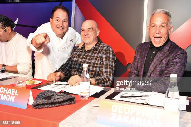 Chefs Josh Capon Michael Symon and Geoffrey Zakarian attend the Food Network Cooking Channel New York City Wine Food Festival presented by CocaCola...