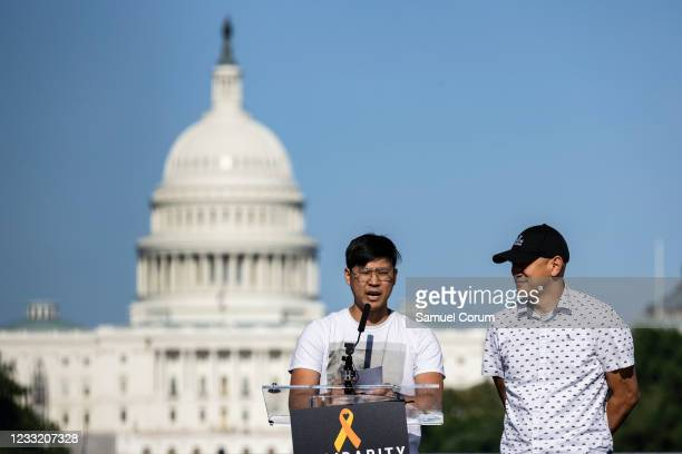 Chefs Kevin Tien and Tim Ma of Chefs Stopping AAPI Hate take part in a rally on the National Mall on May 31, 2021 in Washington, DC. Members and...