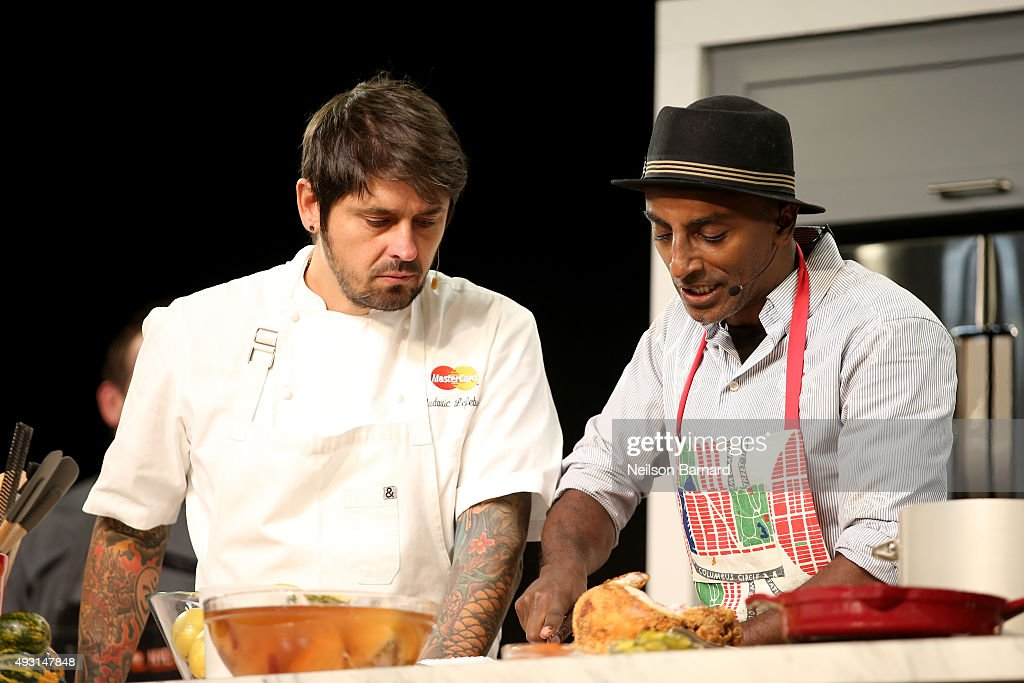 Chefs Ludo Lefebvre and Marcus Samuelsson prepare food on stage the Grand Tasting presented by ShopRite featuring Samsung culinary demonstrations presented by MasterCard - Food Network & Cooking Channel New York City Wine & Food Festival presented by FOOD & WINE at Pier 94 on October 17, 2015 in New York City.