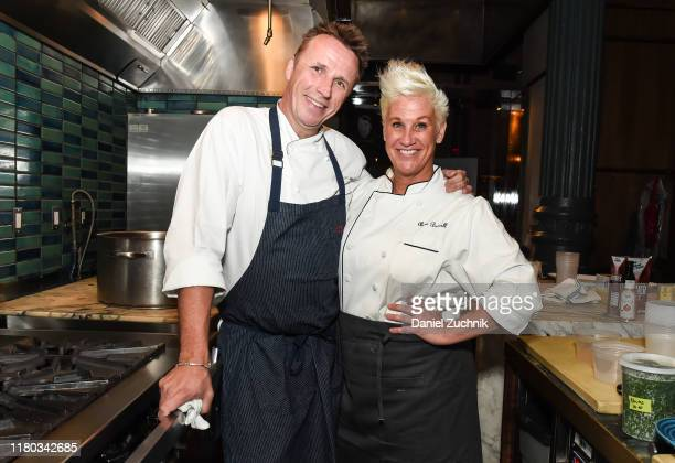 Chefs Marc Murphy and Anne Burrell pose during the Food Network Cooking Channel New York City Wine Food Festival presented by Capital One Dinner with...