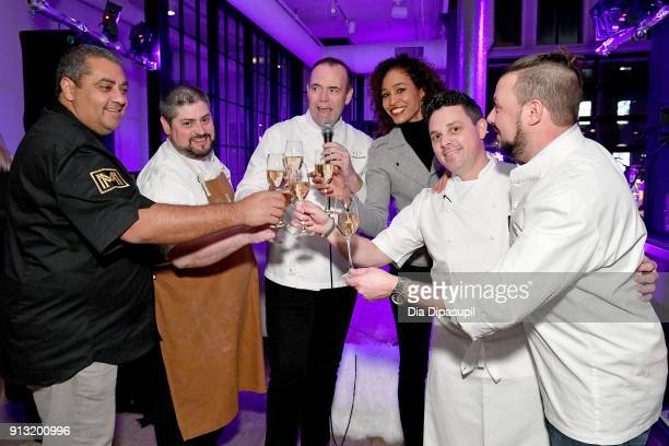 Chefs Michael Mina Scott Romano and Charlie Palmer TV personality Sage Steele and chefs Gavin Kaysen and Adam Sobel toast at the #Culinary Kickoff at...