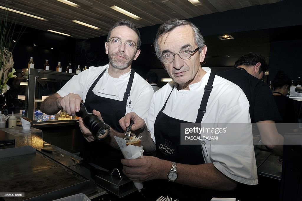 Chefs Michel Bras (R) and his son Sebastien pose as they prepare a buckwheat flour wrap called 'Le Capucin' at their new restaurant 'Capucin' in Toulouse on January 25, 2014. The Michelin-starred chefs, fervent promoters of their native Aveyron region, have launched a new fast-food restaurant in Toulouse that celebrates local produce.