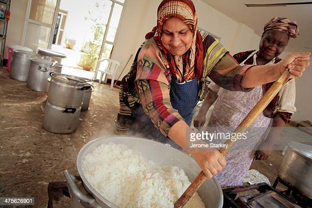Chefs Nyama el-Shebi and Fatima Siku Ubaker prepare rice for Libyan rebels on the frontlines against Colonel Muammar Gaddafi's forces, May 12, 2011....