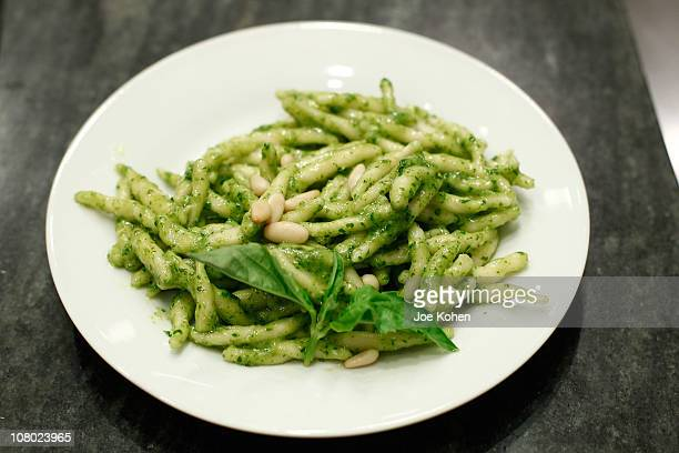 Chefs participate in a pesto making championship during the International Day of Italian Cuisines worldwide launch at The Italian Culinary Academy at...