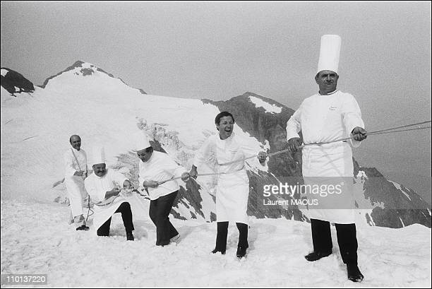 5 chefs Paul Bocuse with Pierre TroisgrosAlain chaPelGeorges BlancJacques Pic in Alpe d'HuezFrance on July 28th1983