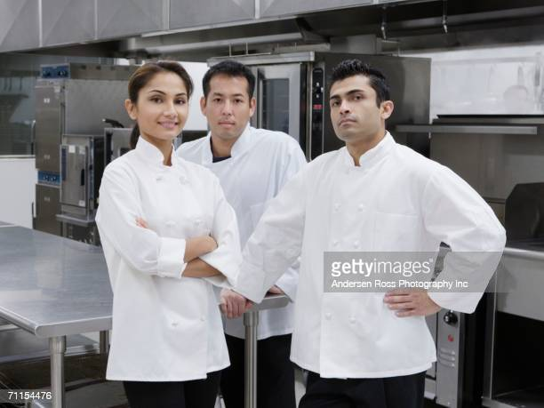 Chefs posing in kitchen