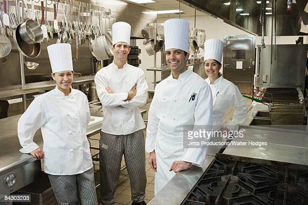 Chefs posing in kitchen
