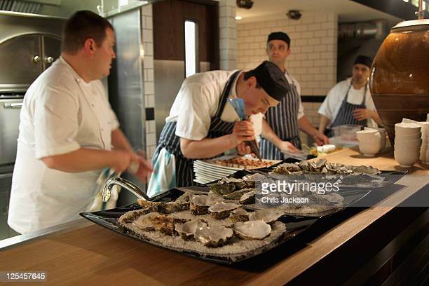 Chefs prepare food at the Jonathan Saunders official London Fashion Week party at Bread Street Kitchen One New Change for London Fashion Week...