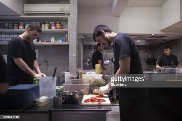 Chefs prepare food in the kitchen of Gaggan restaurant in Bangkok Thailand on Thursday May 4 2017 After his restaurant's third straight win in Asia's...