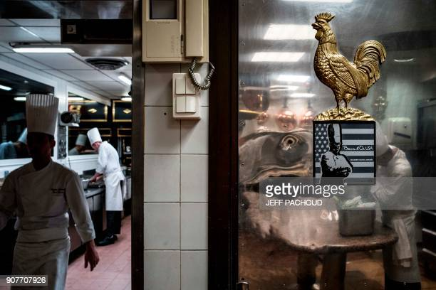 Chefs prepare food in the kitchen of the Paul Bocuse restaurant 'L'auberge du Pont de Collonges' on January 20 2018 in CollongesauMontd'Or near Lyon...