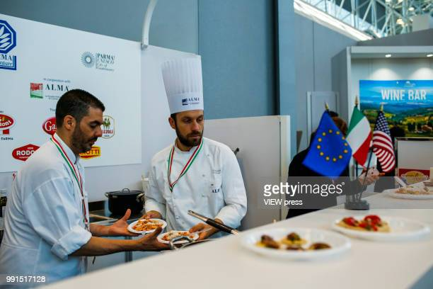 Chefs prepare pasta during The Summer Fancy Food Show at the Javits Center in the borough of Manhattan on July 02 2018 in New York The Summer Fancy...