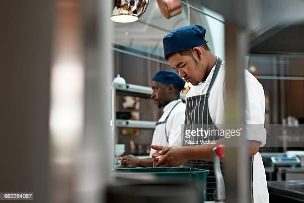 Chefs preparing commodities in kitchen