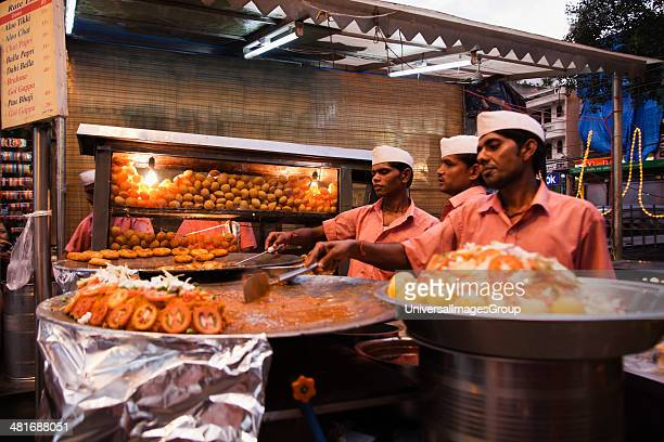 Chefs preparing Indian snacks at a food stall Chandni Chowk Old Delhi India