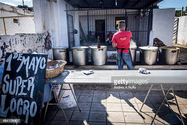 CONTENT] Chefs preparing Locro to sell on Labor Day in the city of Villa Allende Cordoba Argentina