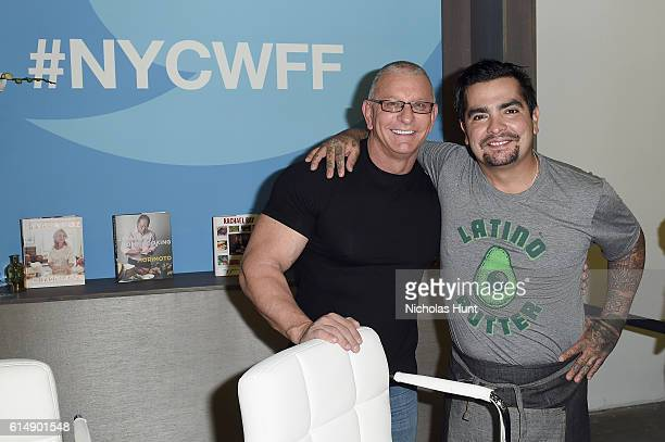 Chefs Robert Irvine and Aaron Sanchez attend the Food Network Cooking Channel New York City Wine Food Festival Presented By CocaCola Grand Tasting...