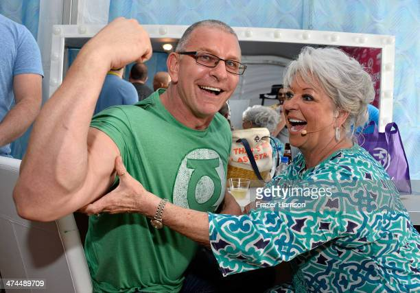 Chefs Robert Irvine and Paula Deen attend KitchenAid® Culinary Demonstrations during the Food Network South Beach Wine Food Festival at Grand Tasting...