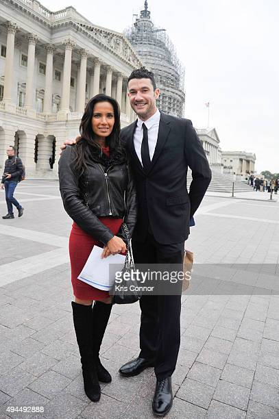 Chefs Sam Talbot with Padma Lakshmi pose for a photo on the capitol steps as they came together on Capitol Hill for a day of action and advocacy with...