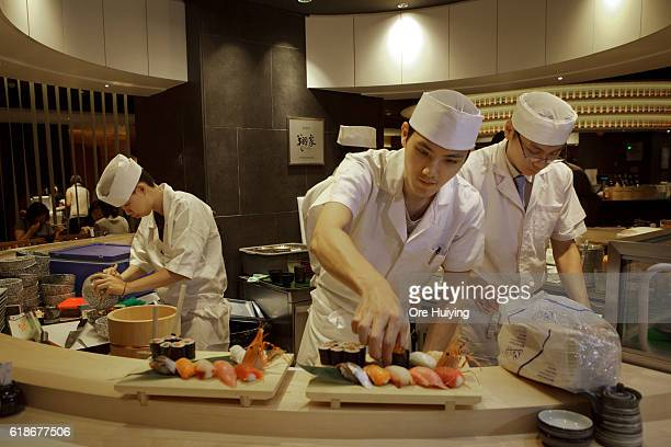 Chefs serve sushi at the casual dining area Noren in ISETAN The Japan Store Kuala Lumpur LGF THE MARKET experience the seasonal flavors section on...
