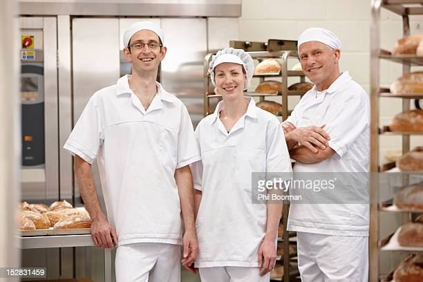 Chefs smiling together in kitchen