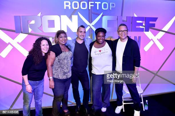 Chefs Stephanie Izard Marc Forgione and Masaharu Morimoto pose with guests at the Food Network Cooking Channel New York City Wine Food Festival...