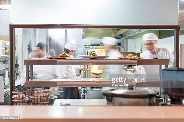 Chefs working in restaurant kitchen